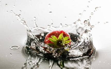 Strawberry dropped in Water